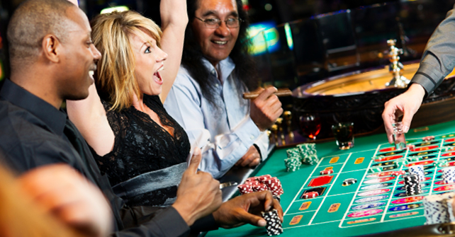 Cancún Resort Las Vegas - Book Direct - Woman celebrating a win at a Las Vegas Casino